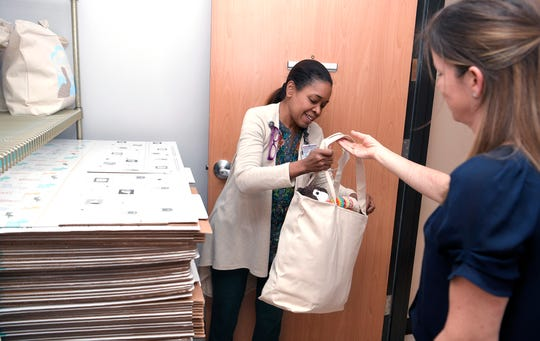 Lena Levendoski, right, drops off bags of clothing and blankets for newborns in need, at Nashville General Hospital at Meharry with Marecha Jackson, director of nursing education at the hospital, on Wednesday,  March 28, 2019.   Levendoski started a non-profit, Strick's Gift, that collects infant clothes to give to some of these newborns in need, as a way to give them hope and tokeep the memory of her son alive.