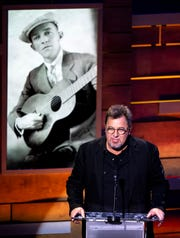 Vince Gill speaks during the Country Music: A Concert Celebrating the film by Ken Burns concert at the Ryman Auditorium in Nashville, Tenn., Wednesday, March 27, 2019.