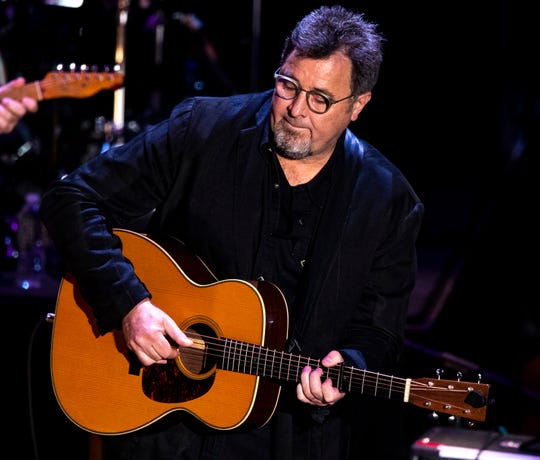 Vince Gill performs during the Country Music: A Concert Celebrating the film by Ken Burns concert at the Ryman Auditorium in Nashville, Tenn., Wednesday, March 27, 2019.