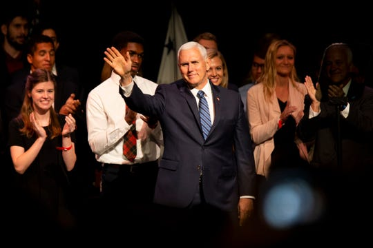 Vice President Mike Pence waves to the crowd as he takes the stage at the O'Bryan Performance Hall in the Thomas and Selby Prince Building at Ave Maria University on Thursday, March 28, 2019.