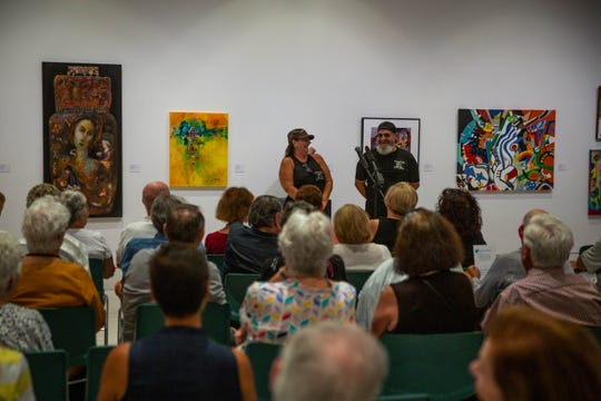 Julie Dana and Ray Garcia tell their story at the Storytellers Project Night at Naples Art Association in Naples on March 27, 2019.
