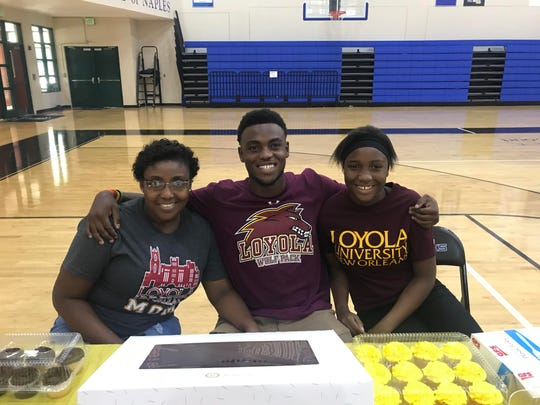 Jackenson Felix poses for a picture with his family prior to signing with Loyola-New Orleans on Tuesday.