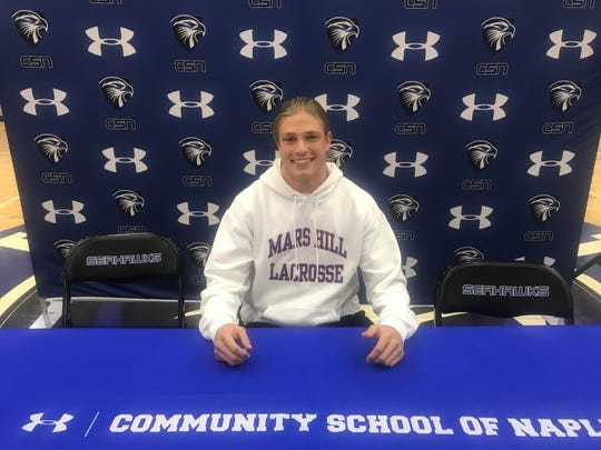 CSN's Sebastian Youngs poses for a picture after signing with Mars Hill on Tuesday. He will be playing Lacrosse for the Mountain Lions.