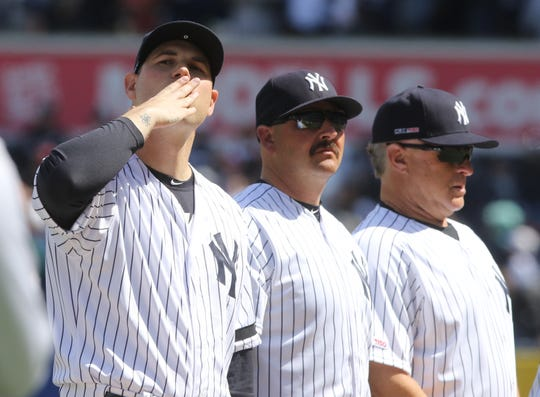 Relief pitcher Adam Ottavino throws a kiss to someone in the crowd after he was introduced during Opening Day ceremonies.