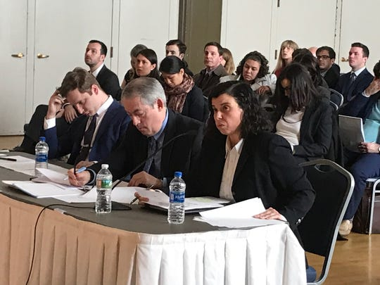 Gulsen Kama, right, who filed a whistleblower complaint against her former employer, testified before a task force investigating New Jersey's tax incentive programs on March 28, 2019.