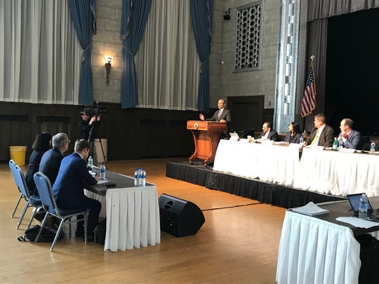 A task force investigating New Jersey's tax incentive programs holds its first public hearing in the Trenton War Memorial on March 28, 2019.