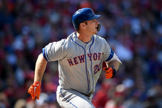 New York Mets' Pete Alonso runs towards first on his single during the eighth inning of a baseball game against the Washington Nationals, Thursday, March 28, 2019, in Washington. The Mets won 2-0. (AP Photo/Nick Wass)