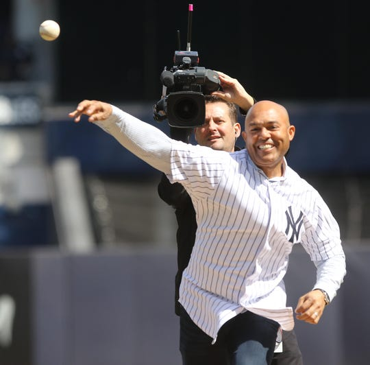 Former Yankee relief pitcher Mariano Rivera throws out the first pitch to start the season for the Yankees.