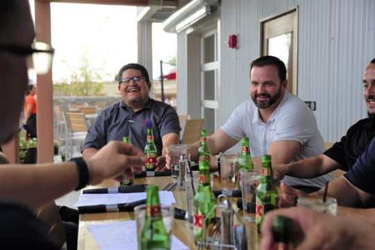 Jose Belmontes, left, and Mike Hudson, right, enjoy a few beers at The Broken Spoke Taphouse at The Amador, 302 S. Main St., Wednesday, March 27.