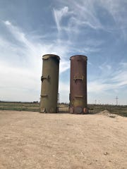 Thermal oxidizers flare natural gas at an oil well site in Otis, New Mexico.