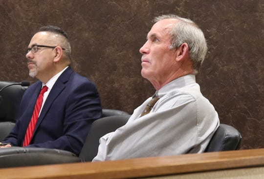 City of Carlsbad Administrator Michael Hernandez (left) and Ward 4 City Councilor Mark Walterscheid watch a presentation on zoning changes during the March 26 City Council meeting.