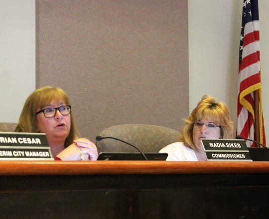 Alamogordo City Commissioner Nadia Sikes, left, speaks during the regular Alamogordo City Commission meeting March 26. To her right is Alamogordo City Commissioner Susan Payne.