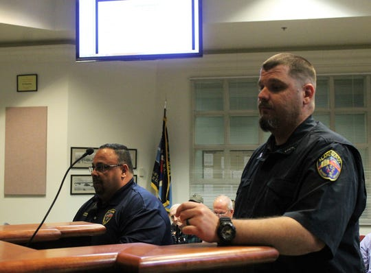 Left, animal Control Manager Dwaine Martinez and Animal Control Officer Walter Oppie discuss the updated animal ordinance at the regular Alamogordo City Commission meeting March 26.