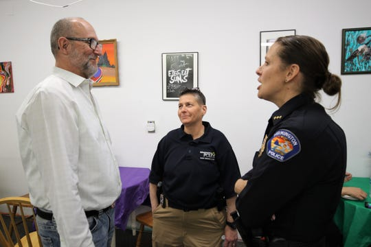 Identity Inc. board Treasurer Donald Stage, left, speaks with District Coordinator Unit Officer Michele DeLese, center, and Deputy Chief Jessica Tyler, right, of the Farmington Police Department during the Bridging the Gap event to show appreciation for local law enforcement at the Farmington nonprofit Wednesday afternoon.
