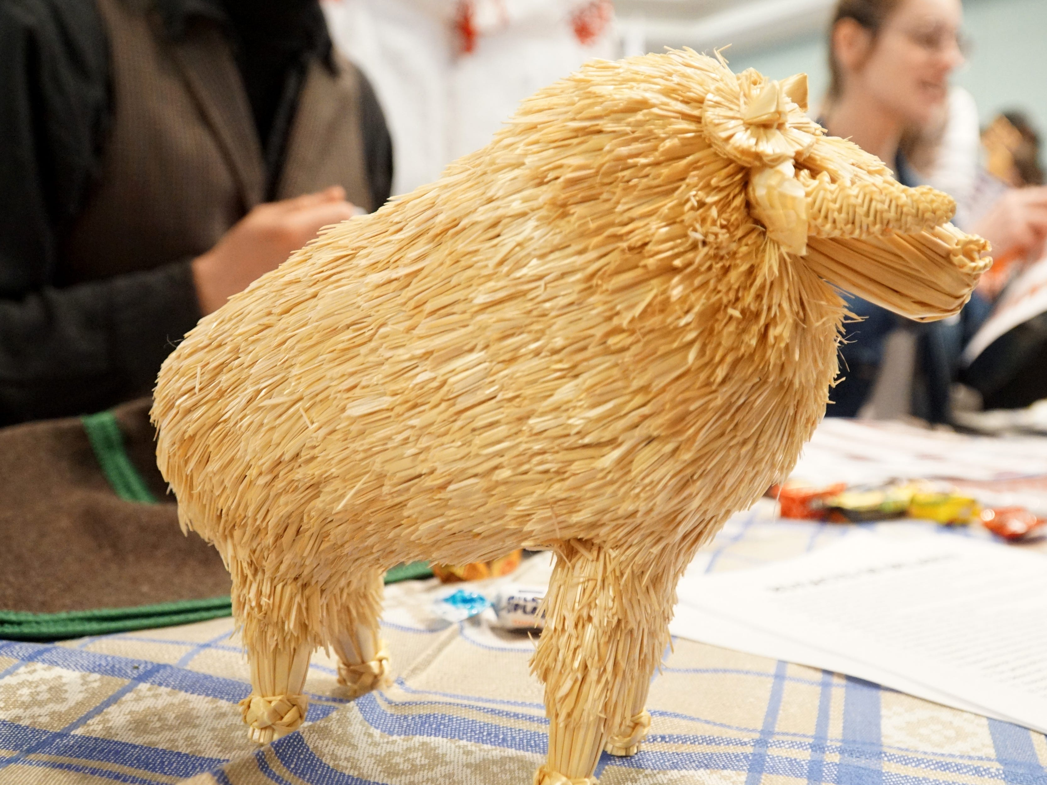 A ram crafted out of straw is displayed at the Belarus booth at Schoolcraft's Multicultural Fair.