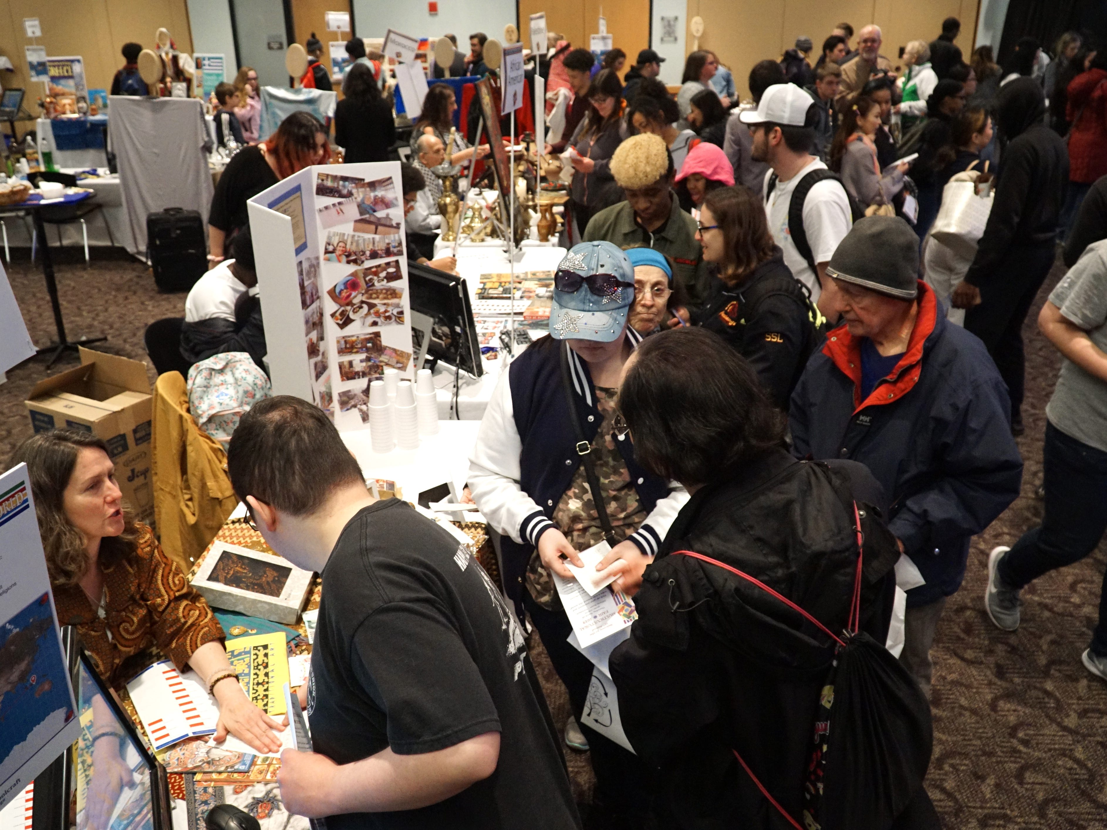Attendees of the Schoolcraft College Multicultuiral Fair check out various information booths in the DiPonion room on March 28, 2019.