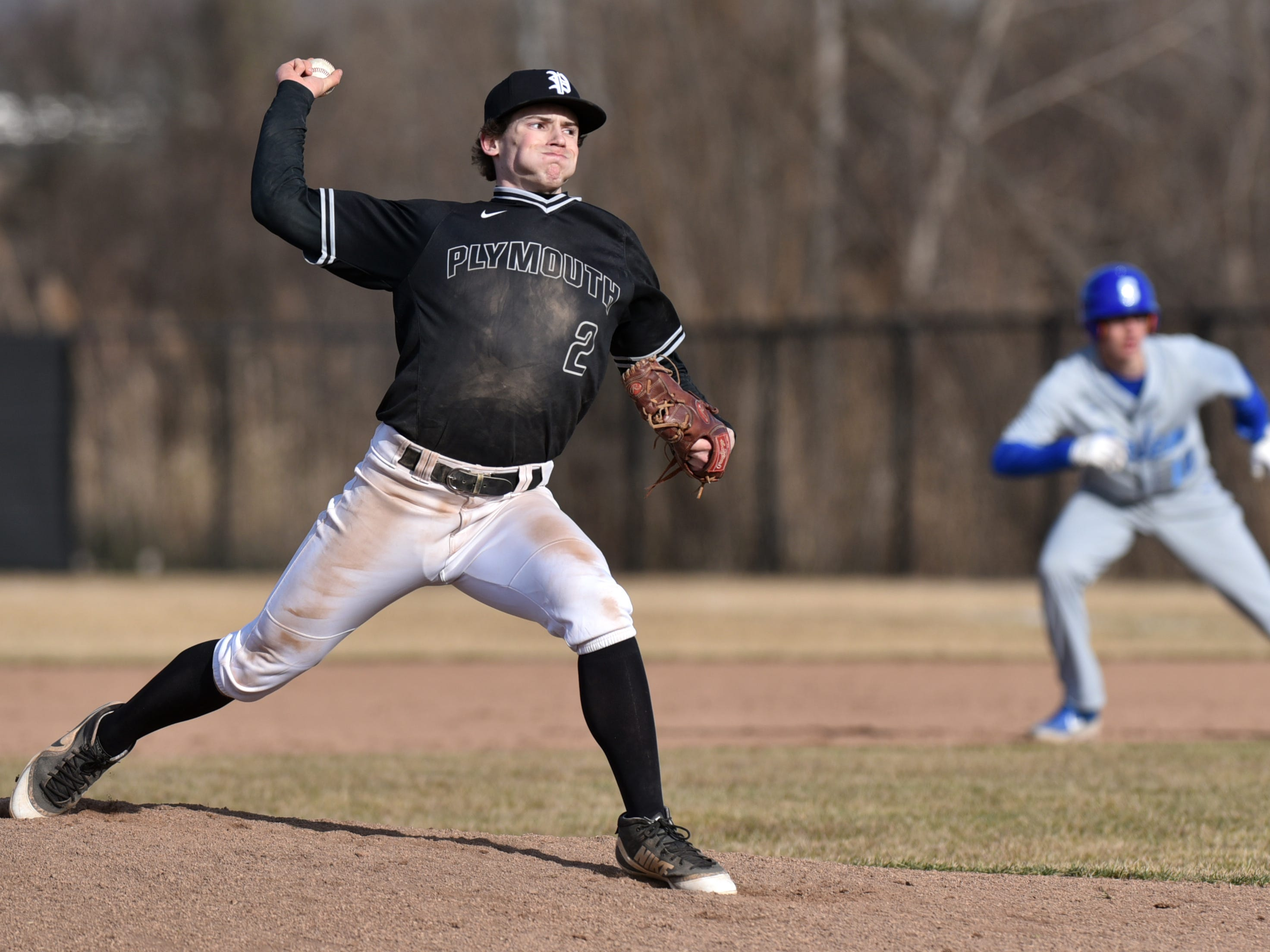 With a runner on first Wildcat pitcher Nick Koski works to home.