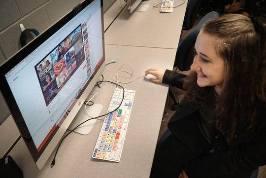 Sydni Rotenberg watches her distracted driving PSA video at North Farmington High School. Rotenberg, a senior, and her co-producer Michael Soverinksky had about a week to make the musical video.