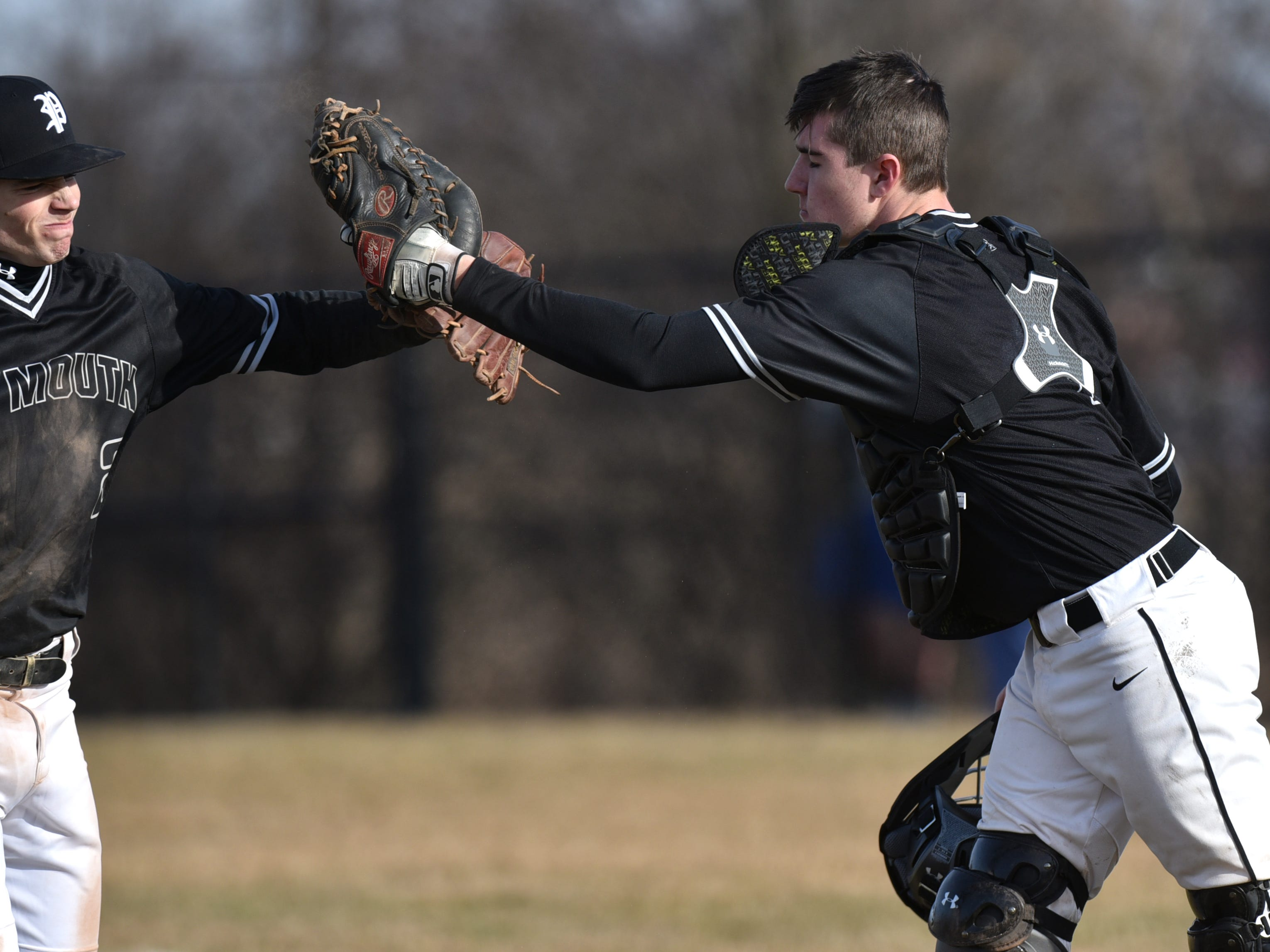 After getting out of a sticky jam in the sixth, Wildcat pitcher Nick Koski, left, gets an atta-boy from his catcher.