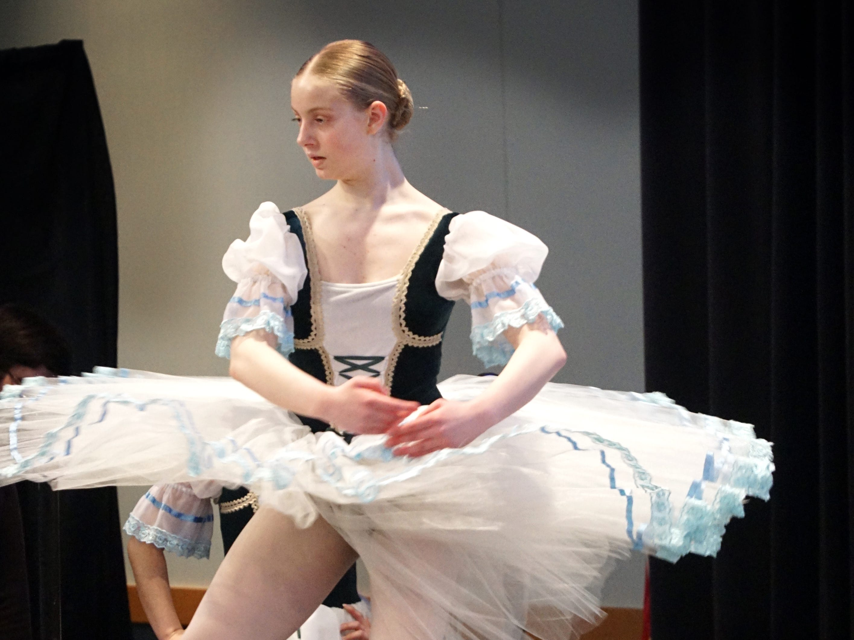 Sarah Davidson, a dancer with the Academy of Russian Classical Ballet, dances at Schoolcraft College's Multicultural Fair on March 28. The fair, which ran from 10 a.m.-3 p.m. in the DiPonio Room, featured information booths, food samples and demonstrations from 24 different countries and cultures and featured musical and dance from 11 different groups including the Mariach Jalisco Band, the O'Hare Irish Step Dancers, and the Marcus Garvey Academy African Drum and Dance Ensemble.