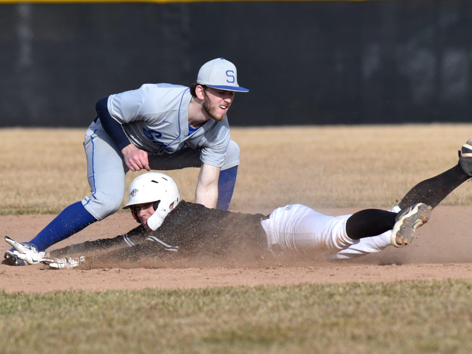 Salem's Jacob Amato tags out Plymouth Wildcat Nick Koski at second base.