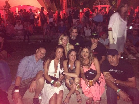 Nicole Clark, second from right in the bottom row, poses with friends at the 2015 Coachella. She went to the first Coachella in 1999 and Goldenvoice's first concert at the Empire Polo Club in 1993, and she's taking her 16-year-old son to this year's Coachella.
