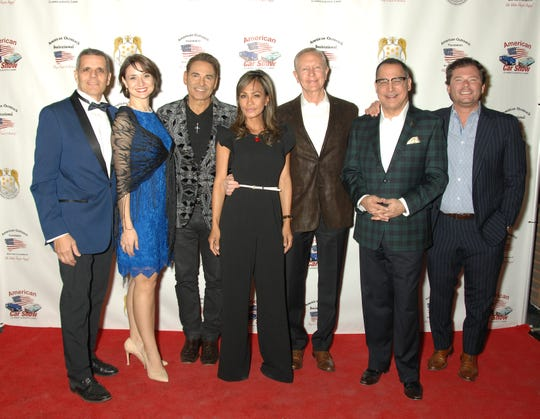 From left, Oscar Llort, American Outreach Foundation president/founder;  Victoria Llort, American Outreach Foundation vice president; Will Donato, saxophone performer; Geri Clark and Walter Clark, Walter Clark Legal Group;  Patrick Evans, emcee; and Pete Potente, American Outreach Foundation board member and CEO of Potente Law.