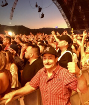 """Brian """"BB"""" Ingle is a face in the crowd at an early Coachella tent show."""