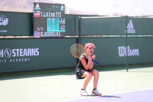 Thea Latak of Darien, Ill., reacts to winning the Adidas Easter Bowl girls' 12s title with a 7-6 (3), 6-3 win over Daniela Borruel.