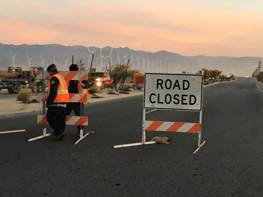 This March 28 photo shows road crews blocking Indian Canyon Drive at Tramview Road. The area is often closed due to blowing sand and local officials are looking for ways to prevent road closures.