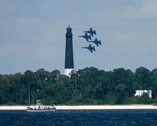 The Blues Angels fly by the Pensacola Lighthouse at Naval Air Station Pensacola. The Blues are back in town, and their first local practice of the 2019 season is set for Tuesday.