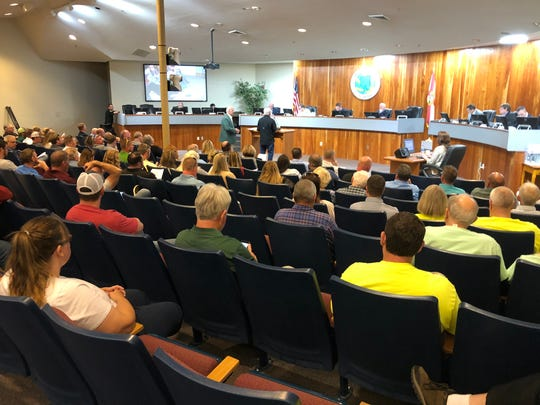 Community members pack the Santa Rosa County Commission chambers on Thursday, March 28 for a special rezoning meeting.