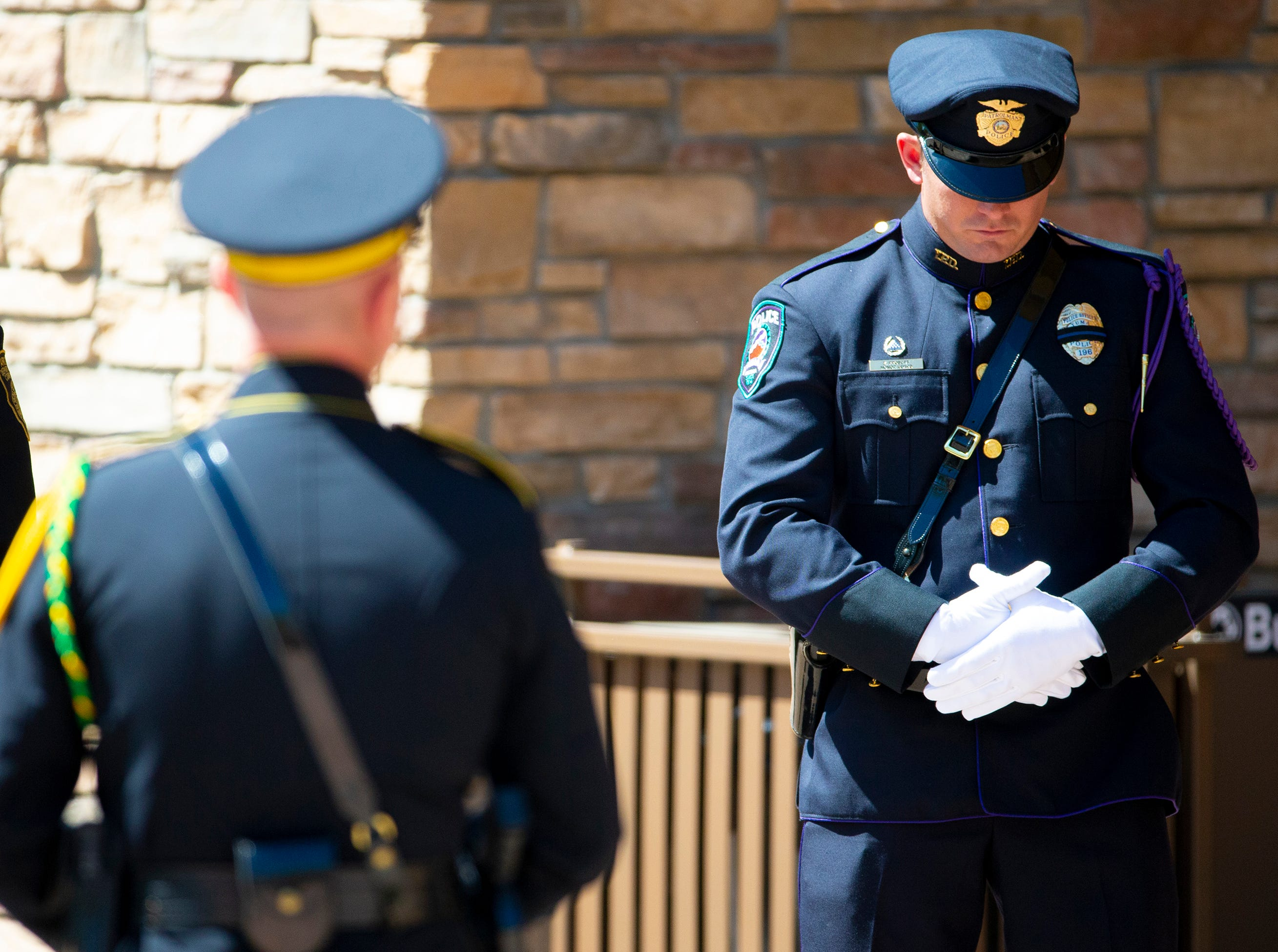 Law-enforcement officers honor Phoenix police Officer Paul Rutherford during funeral services at Christ's Church of the Valley in Peoria on March 28, 2019. Rutherford was killed during a crash investigation March 21.