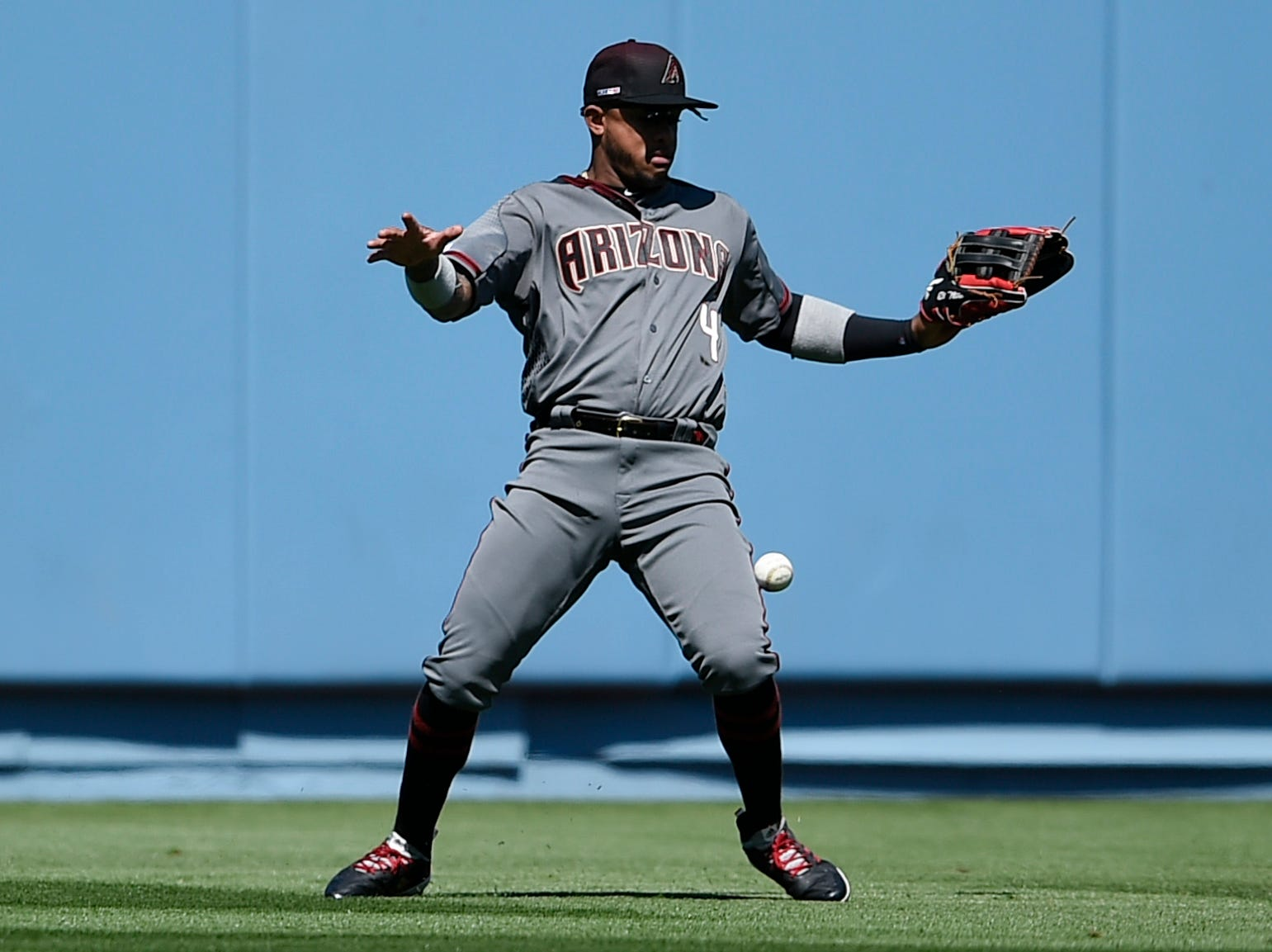 Mar 28, 2019; Los Angeles, CA, USA; Arizona Diamondbacks center fielder Ketel Marte (4) mishandles a ball hit by Los Angeles Dodgers right fielder Cody Bellinger (not pictured) during the fourth inning at Dodger Stadium. Mandatory Credit: Kelvin Kuo-USA TODAY Sports