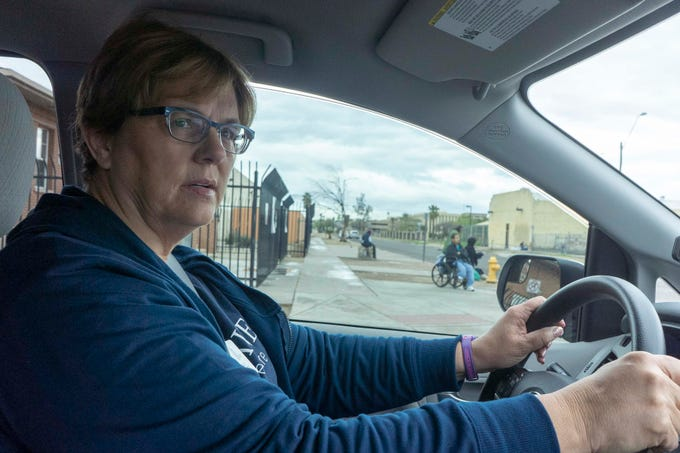 Michelle Detrick, transportation director for a new non-profit called Elaine, drives people experiencing homelessness to and from medical appointments in Phoenix.