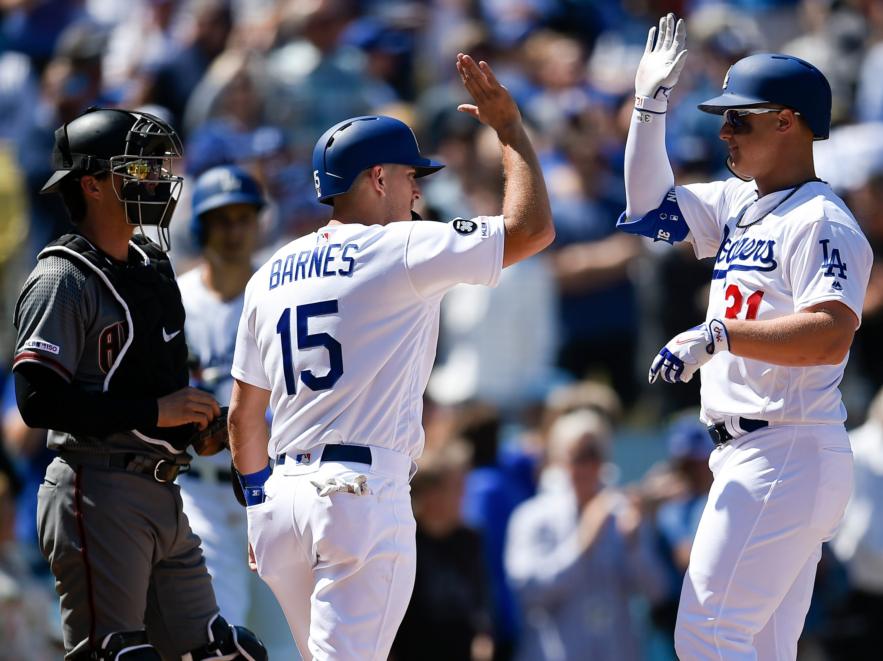 Mar 28, 2019; Los Angeles, CA, USA; Los Angeles Dodgers left fielder Joc Pederson (31) celebrates with catcher Austin Barnes (15) after a two-run home run during the second inning against the Arizona Diamondbacks at Dodger Stadium. Mandatory Credit: Kelvin Kuo-USA TODAY Sports
