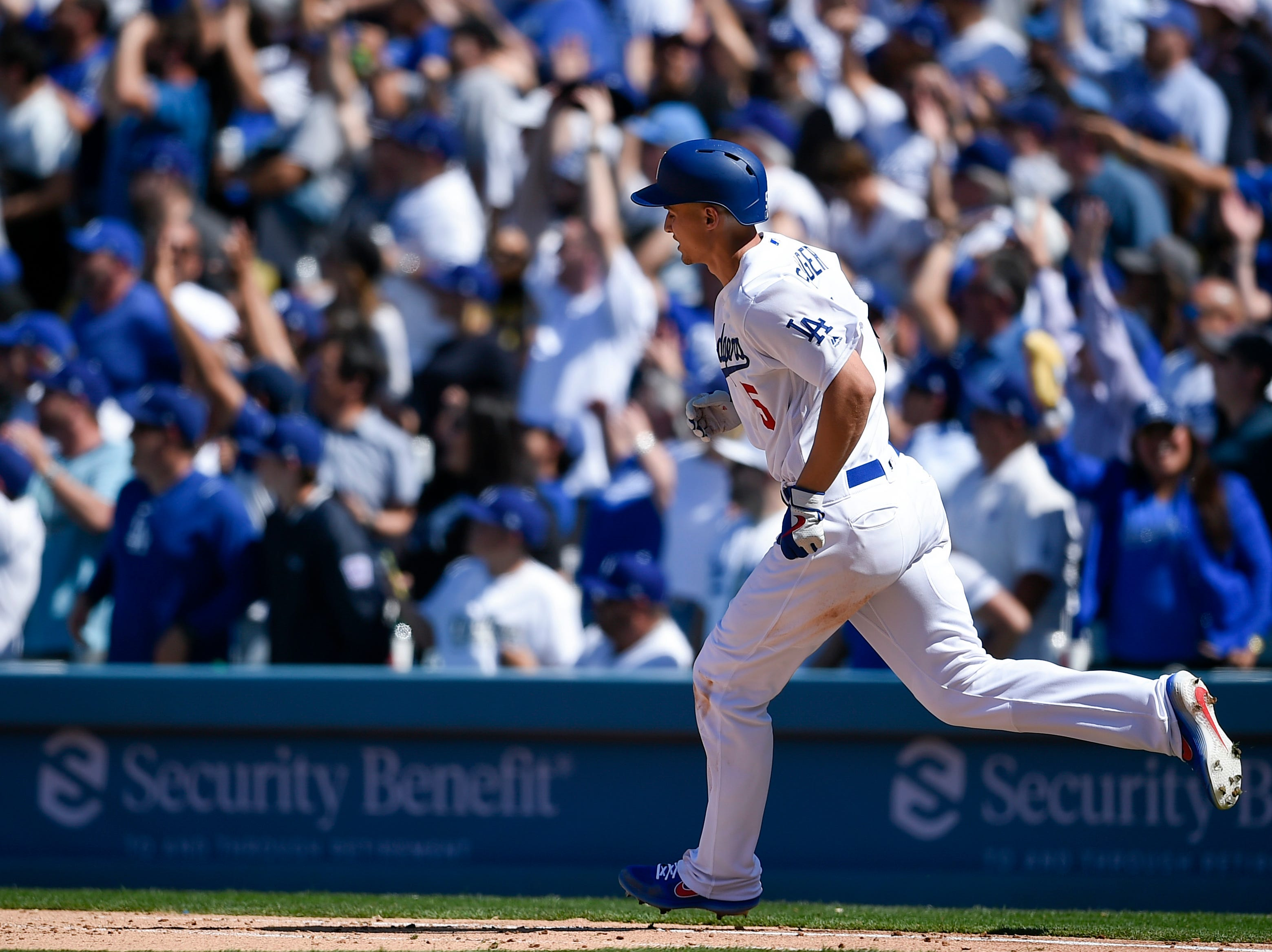 Mar 28, 2019; Los Angeles, CA, USA; Los Angeles Dodgers shortstop Corey Seager (5) rounds the bases after a home run during the fourth inning against the Arizona Diamondbacks at Dodger Stadium. Mandatory Credit: Kelvin Kuo-USA TODAY Sports