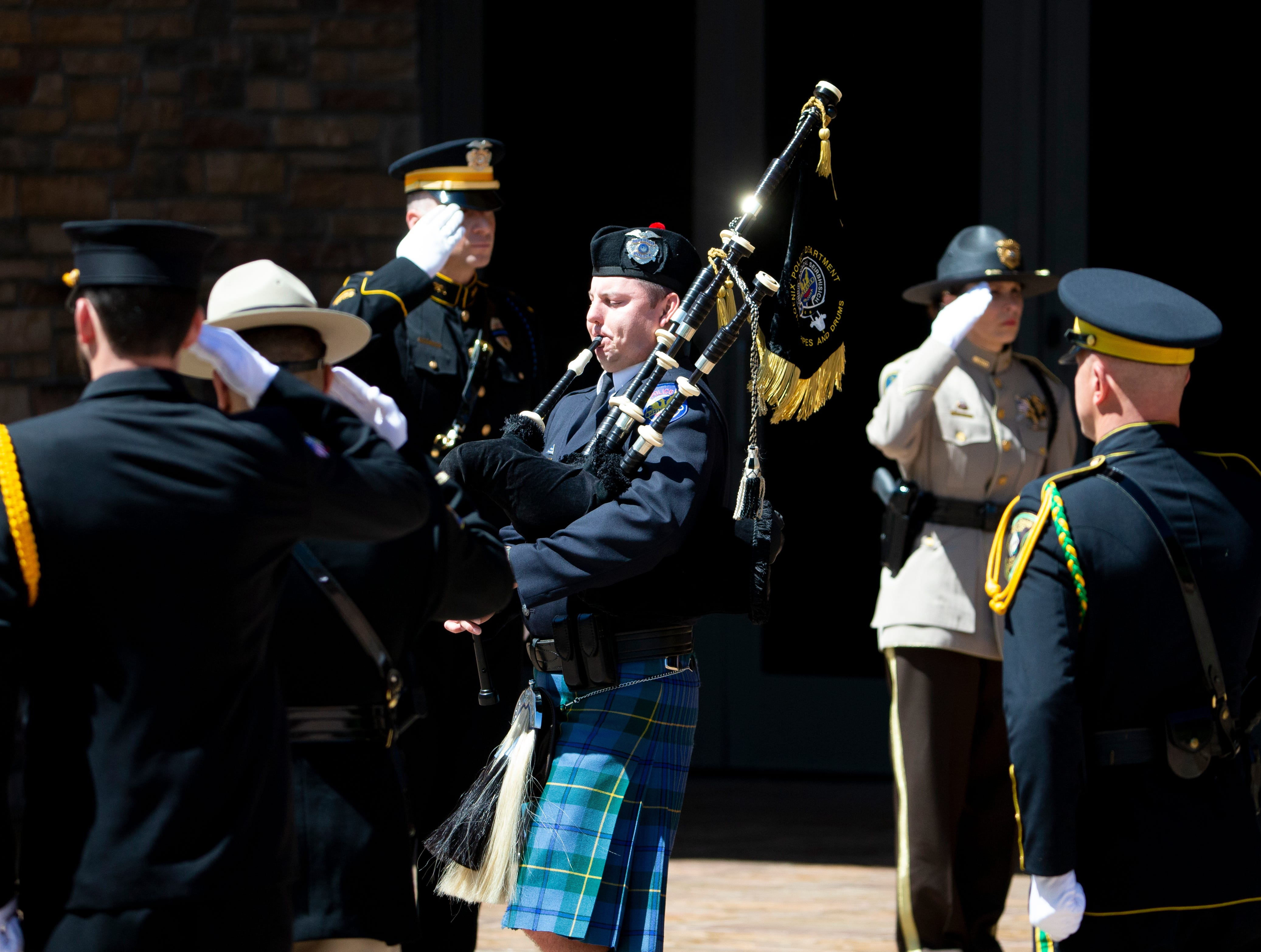 Bagpipes are played during funeral services for Officer Paul Rutherford at Christ's Church of the Valley in Peoria on March 28, 2019. Rutherford was killed in a crash March 21.