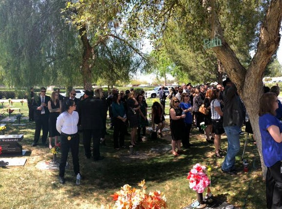 Guests and law-enforcement officials prepare for the ceremony for Phoenix Officer Paul Rutherford at Phoenix Memorial Park on March 28, 2019.
