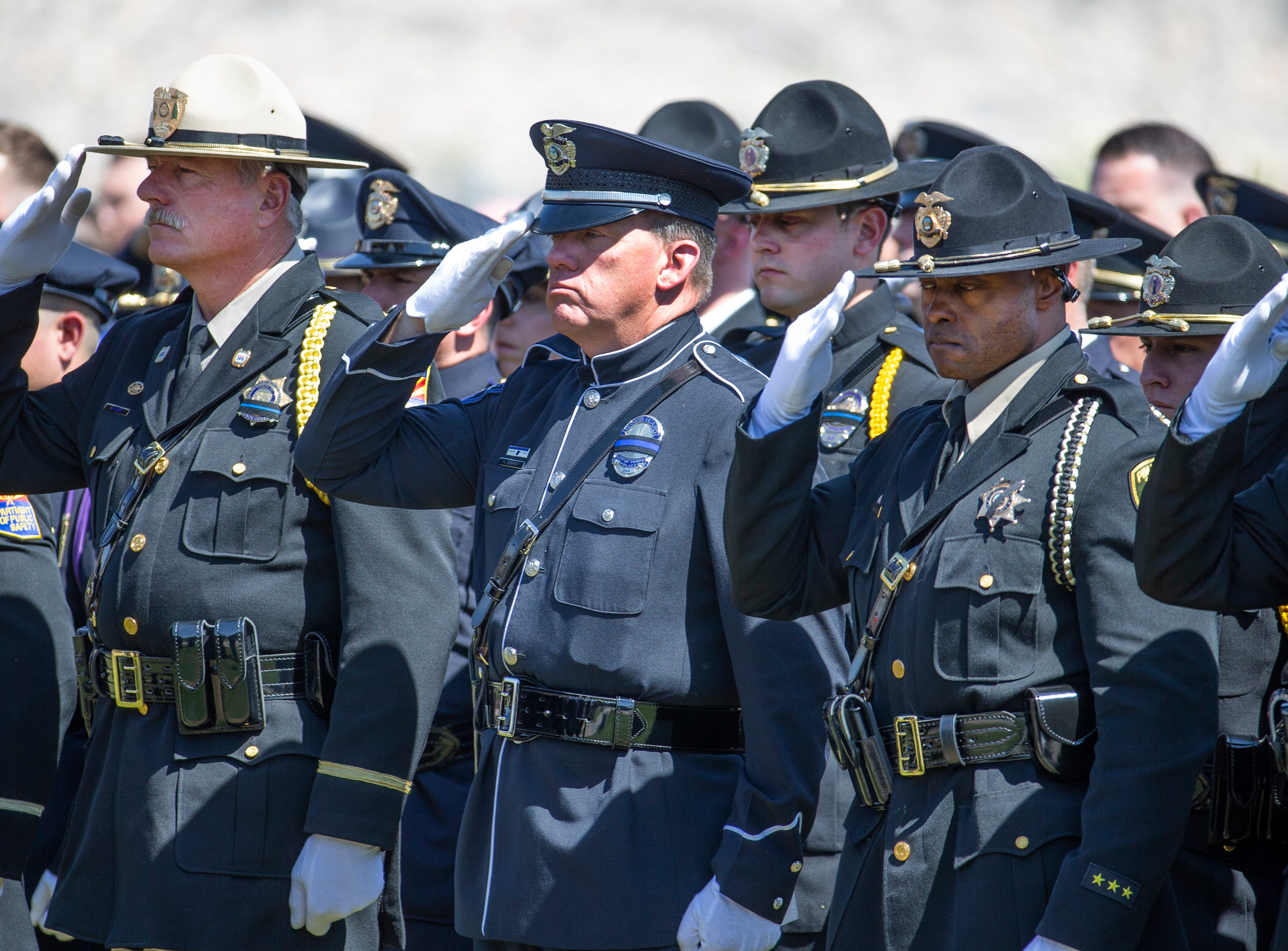 Phoenix police Officer Paul Rutherford is honored by police, firefighters, first responders, family and friends at Phoenix Memorial Cemetery March 28, 2019. Rutherford was killed while investigating the scene of an auto accident in Phoenix.
