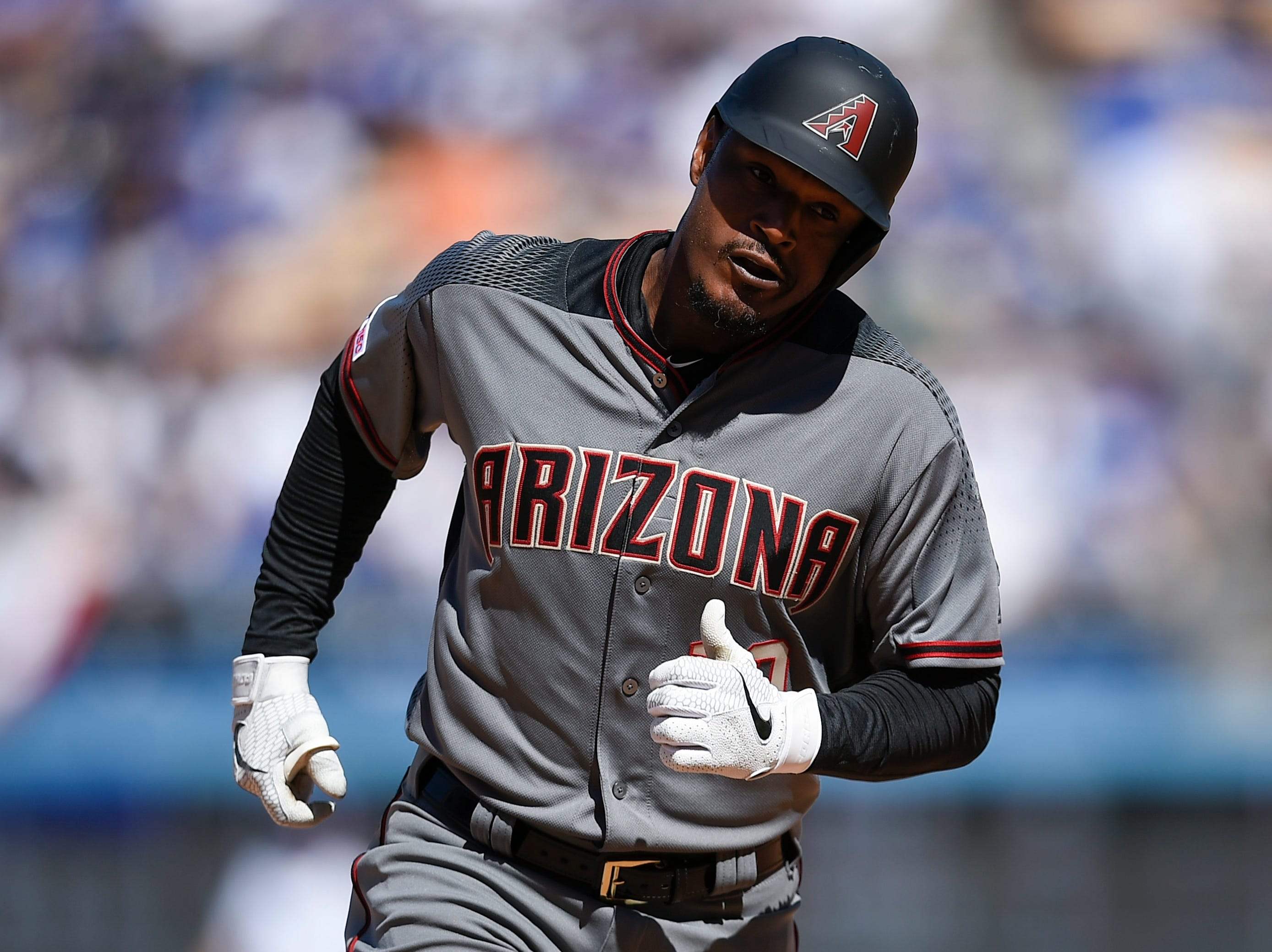 Mar 28, 2019; Los Angeles, CA, USA; Arizona Diamondbacks right fielder Adam Jones (10) rounds the bases after a solo home runduring the sixth inning against the Los Angeles Dodgers at Dodger Stadium. Mandatory Credit: Kelvin Kuo-USA TODAY Sports