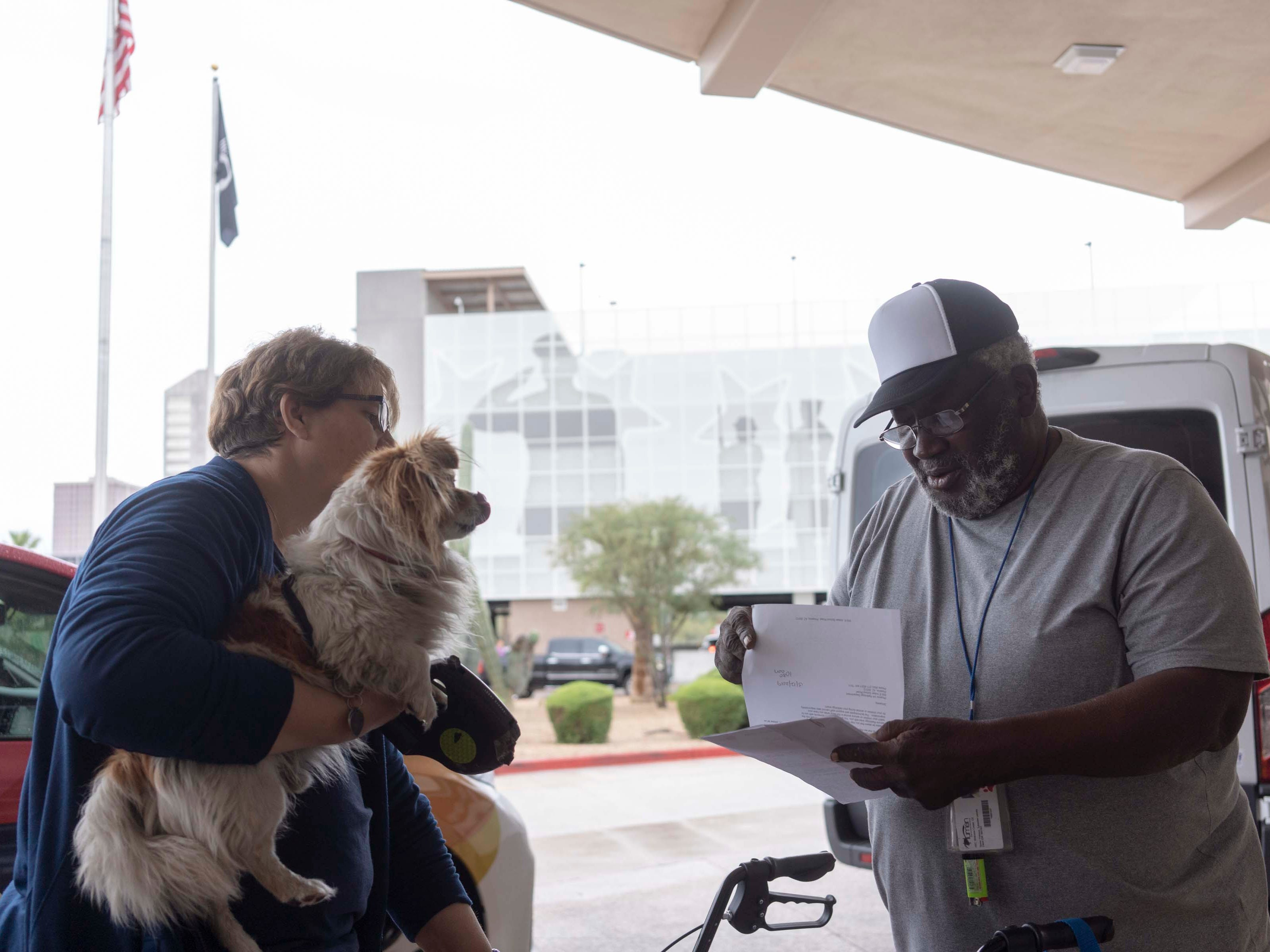 Michelle Detrick gives Army veteran Sylvestre Primous, 71, a ride to the Phoenix VA hospital before taking his service dog to the veterinarian. Detrick works for a new non-profit called Elaine that helps people experiencing homelessness get to and from medical appointments.