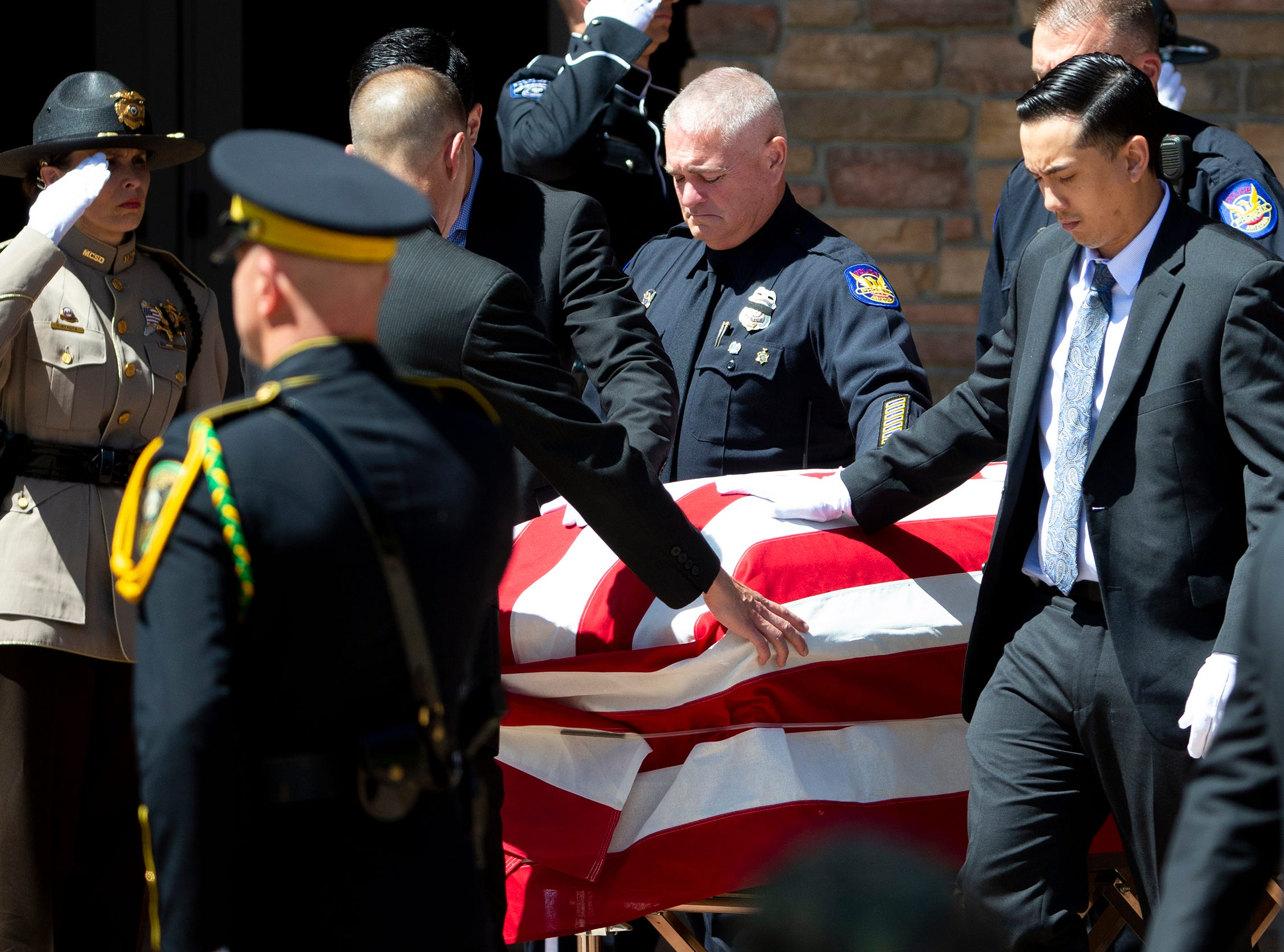 Pallbearers escort the casket of Phoenix Police Officer Paul Rutherford after funeral services at Christ's Church of the Valley in Peoria on March 28, 2019. Rutherford was killed in a crash March 21.