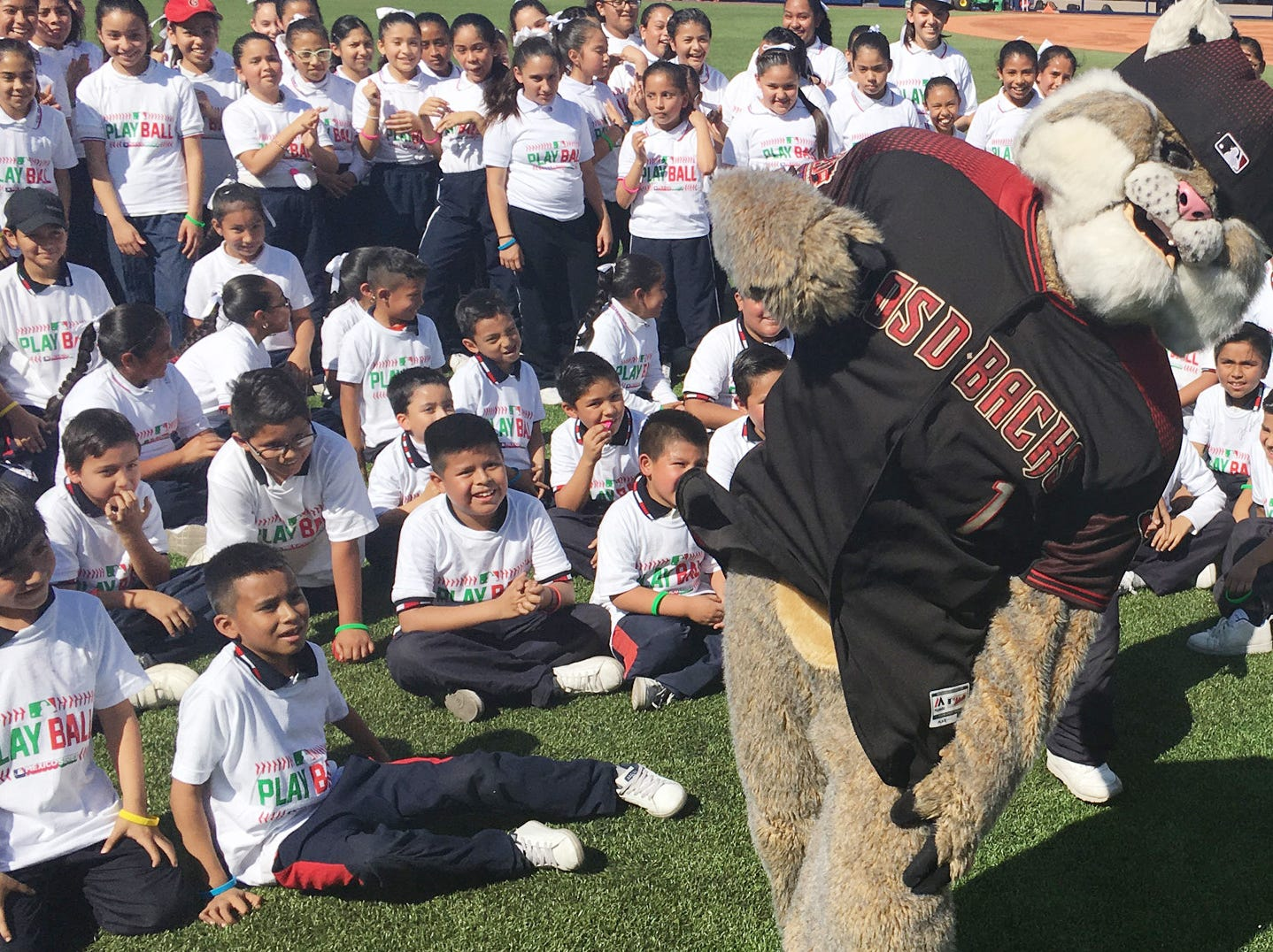 D. Baxter the Bobcat, the Arizona Diamondbacks team mascot, hams it up for children who participated in a Major League Baseball event inside the stadium in Monterrey, Mexico.