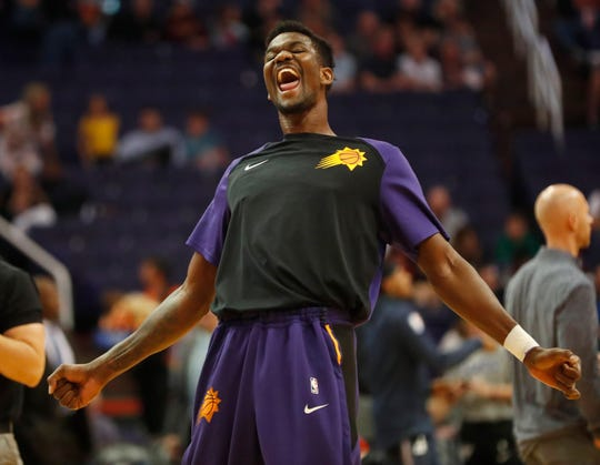 Phoenix Suns center Deandre Ayton (22) has fun before playing against the Washington Wizards in Phoenix March 27, 2019.