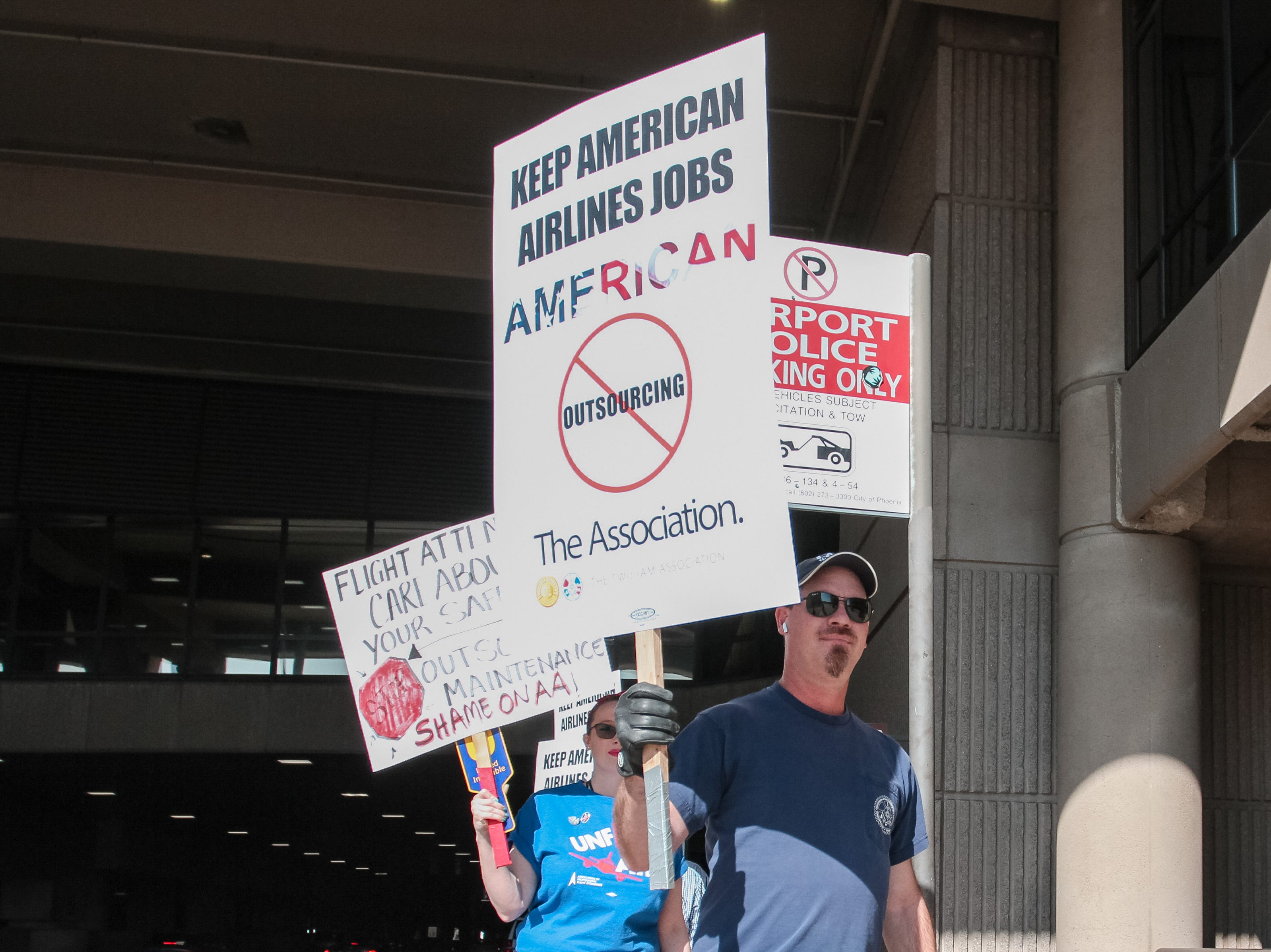 Dozens of picketers gather at Sky Harbor International Airport to protest American Airlines' treatment of employees, in Phoenix on March 28, 2019.