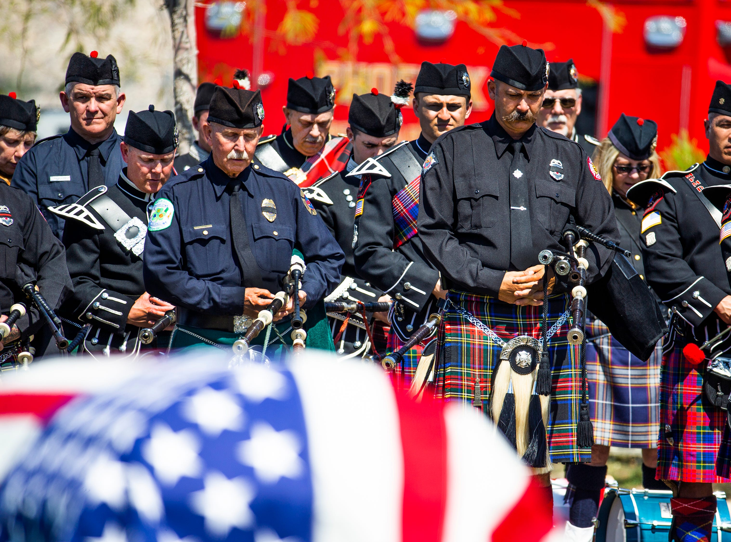 Phoenix police Officer Paul Rutherford is honored with bagpipes at Phoenix Memorial Cemetery March 28, 2019. Rutherford was killed while investigating the scene of an auto accident in Phoenix.