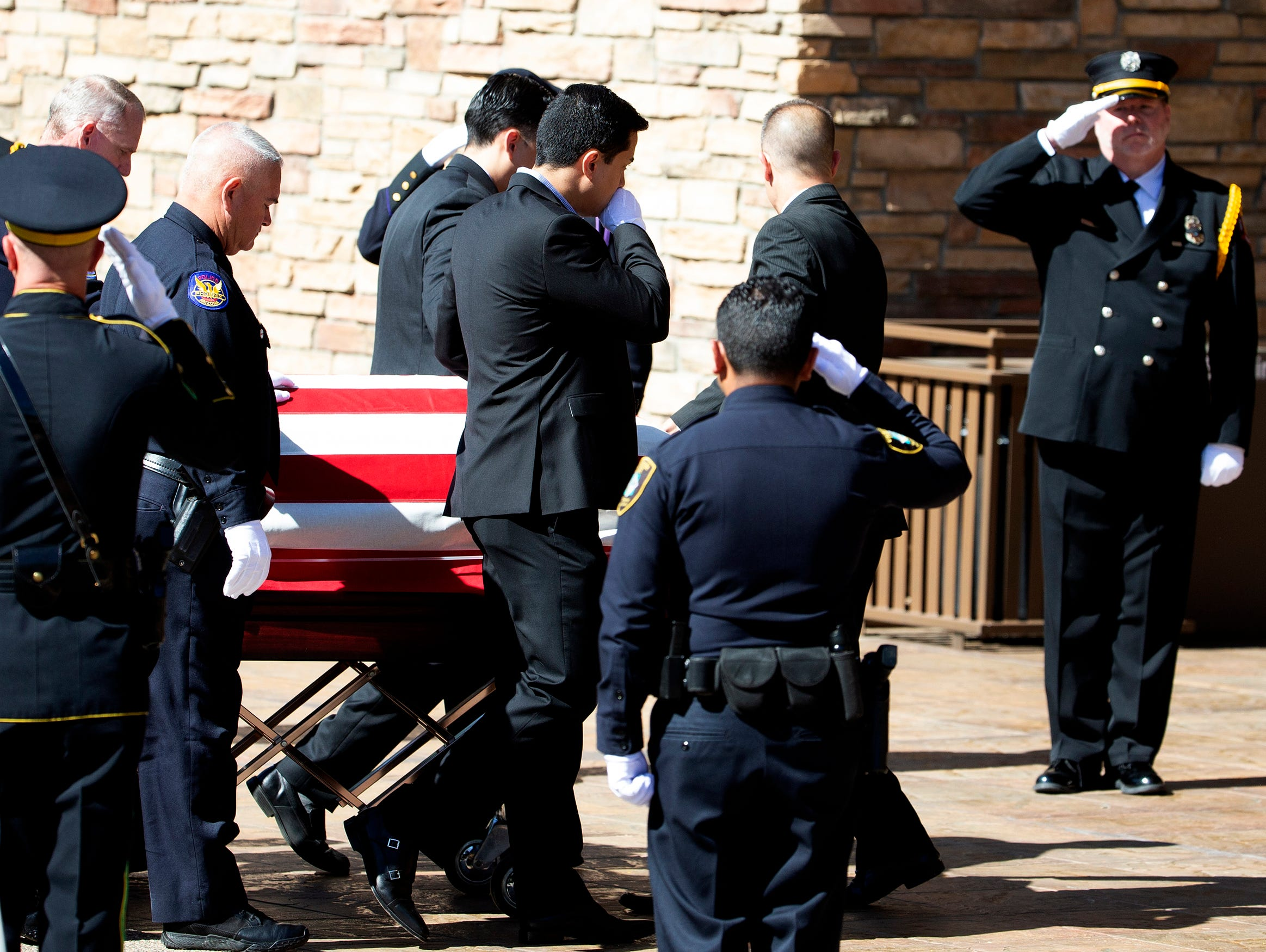 Pallbearers escort the casket of Phoenix police Officer Paul Rutherford during funeral services at Christ's Church of the Valley in Peoria on March 28, 2019.  Rutherford was killed during a crash investigation March 21.