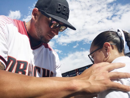 Arizona Diamondbacks outfielder David Peralta autographs a T-shirt. The Diamondbacks sent most of their starters to play two spring-training games against the Colorado Rockies in Monterrey, Mexico. Diamondbacks President and CEO Derrick Hall said the team wanted to show respect to fans who bought tickets for the games.