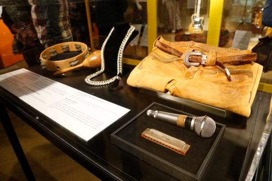 """Clothing, instruments and a microphone all used at the 1969 Woodstock Festival on display for the show, """"We Are Golden"""" at Bethel Woods Center for the Arts on March 28, 2019."""